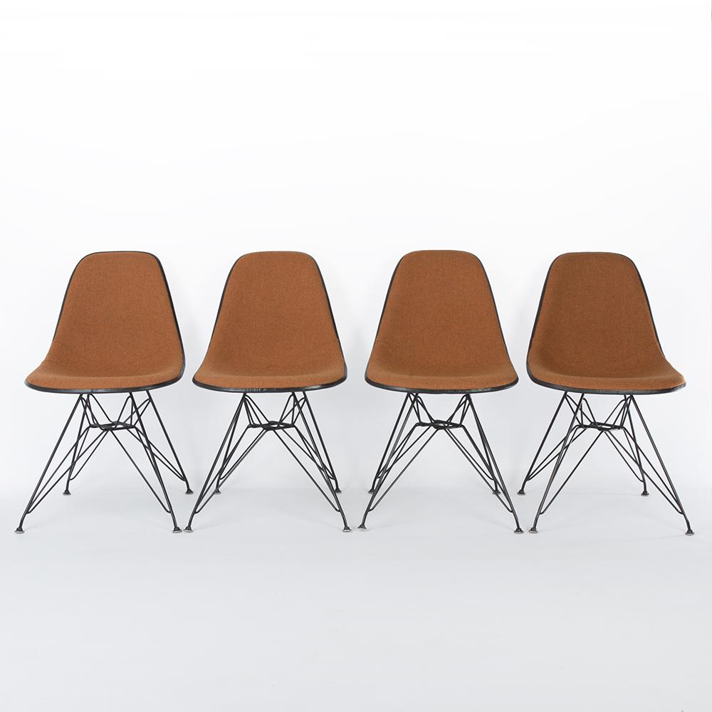 Front view of A Set of 4 Orange & White Herman Miller Eames Original DSR Side Shell Chair