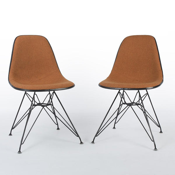 Front view of A Pair Of Speckled Orange And White Herman Miller Eames Original DSR Side Shell Chair