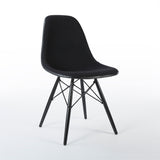 Front angled view of black on white upholstered Eames DSW chair