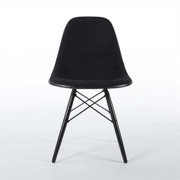 Front view of black on white upholstered Eames DSW chair