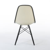 Rear view of black on white upholstered Eames DSW chair