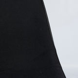 Close up view of upholstery on black on white upholstered Eames DSW chair