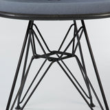 closed up view of Grey Herman Miller Original Eames Upholstered Black DSR Side Shell Chairs