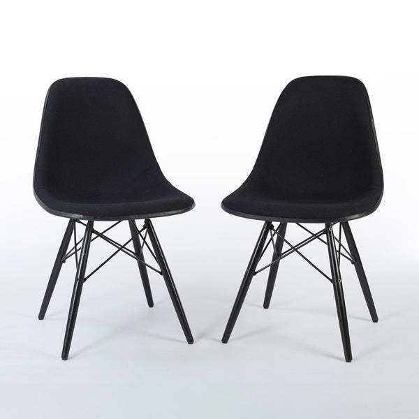 Pair of black on white upholstered Eames DSW chairs from front at angle