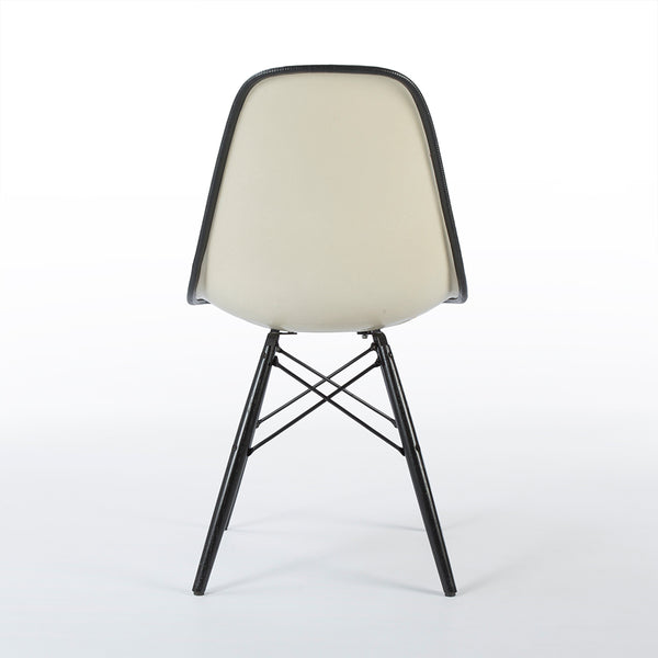 Black on white upholstered Eames DSW chair from rear