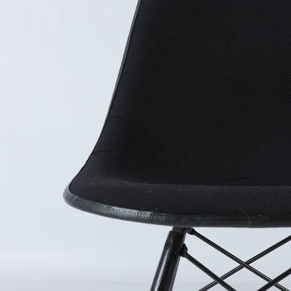 Image of seat top of black on white upholstered Eames DSW chair