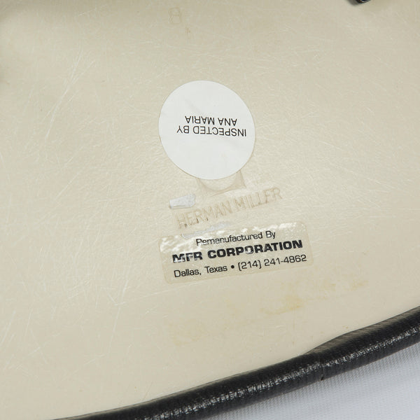 Image of logo on black on white upholstered Eames DSW chair