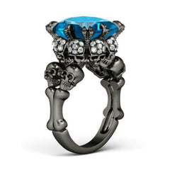 Rhodium Bones and Skull Ring Blue Gem Surrounded By Skulls - Skulltimate