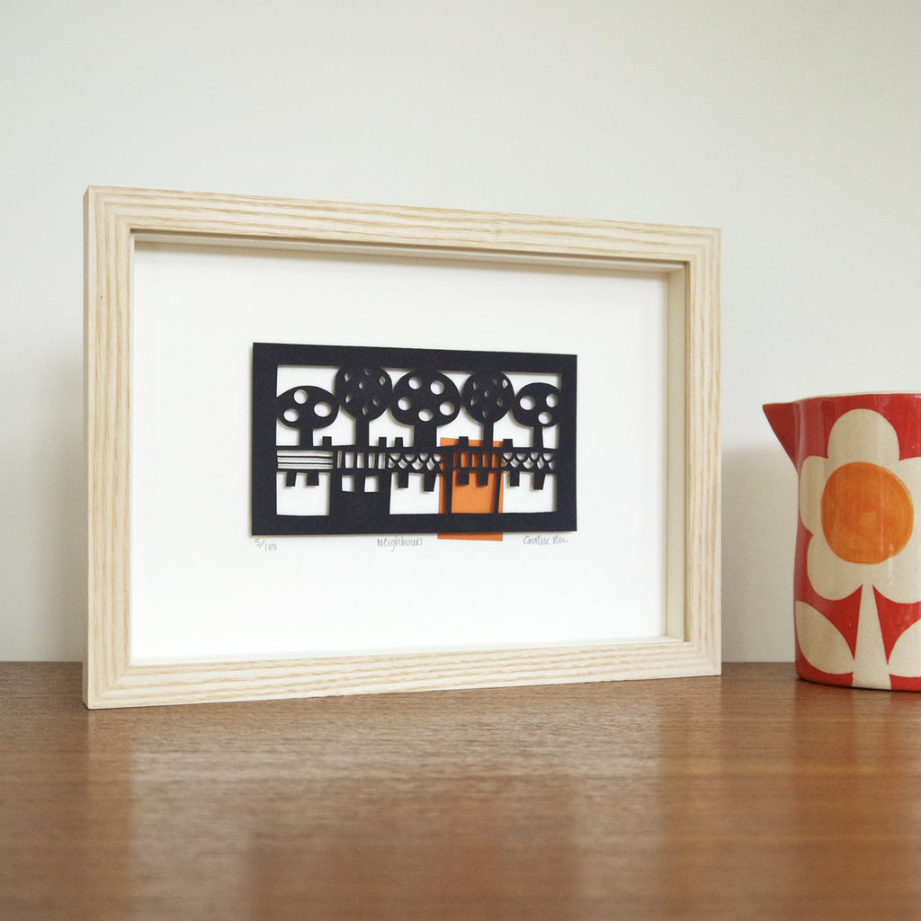 Neighbours papercut framed