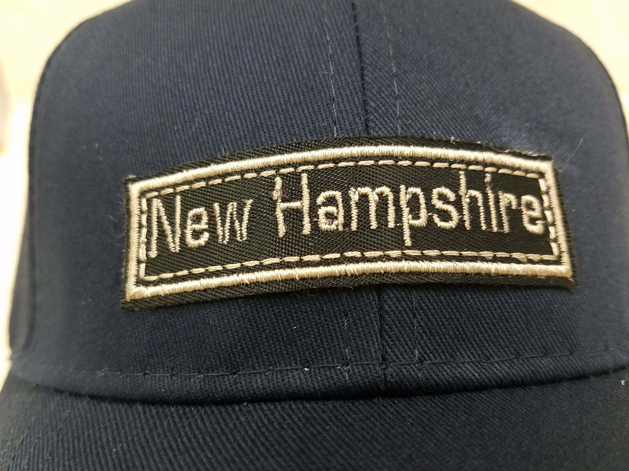 NH Crossed Hunting Rifles Patch Hat