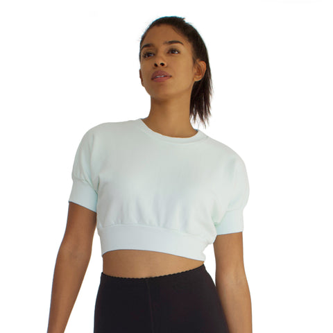The Anita is a 100% cotton French Terry crop top in Mint. Short dolman sleeves with a crew neck.