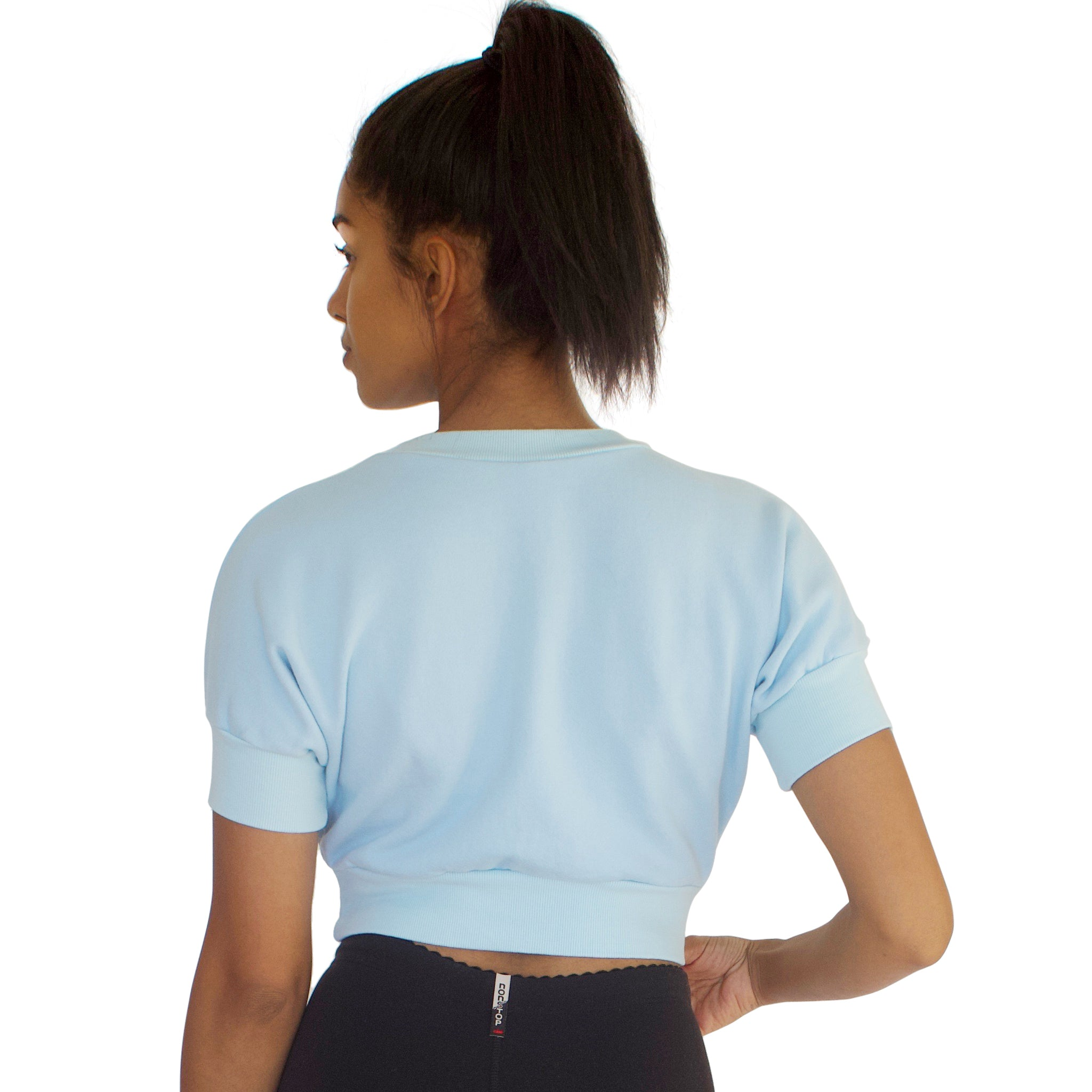 Back view of the 100% cotton French Terry Anita crop top in Sky Blue