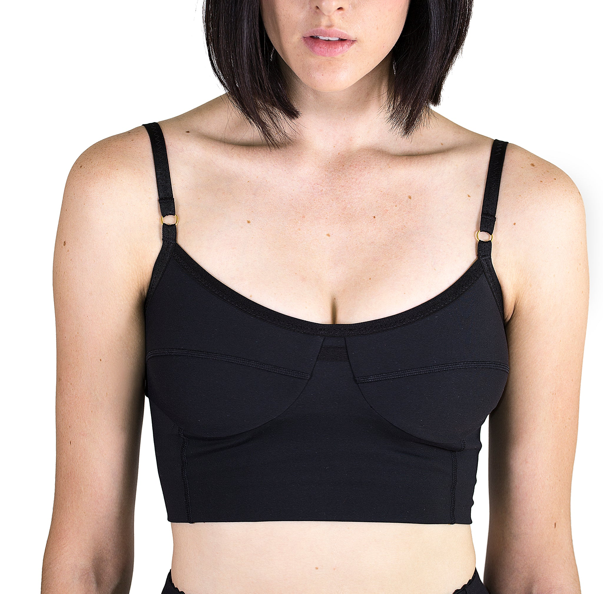 Beautifully designed Bralette in black with grosgrain elastic straps, flattering seam detail and funtional loop at center front.