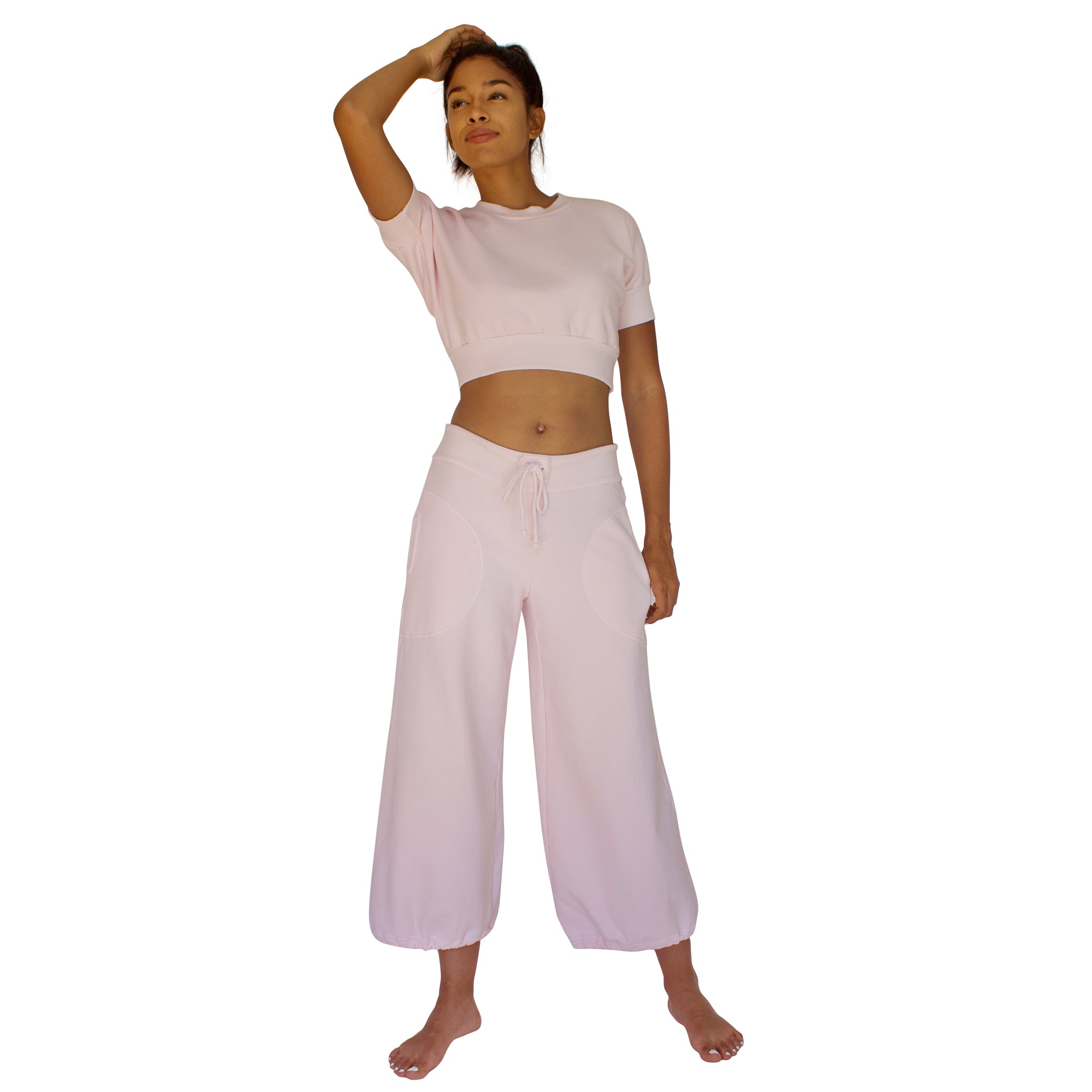 CC Beach Pant in 100% cotton French Terry will keep you comfy and cozy with roomy side seam pockets, drawstring waist, elasticized cuffs shown here in Candy Pink