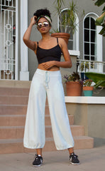 CC Beach Pant in 100% cotton French Terry will keep you comfy and cozy with roomy side seam pockets, drawstring waist, elasticized cuffs shown here in Mint Green and worn with our Bralette in Black.