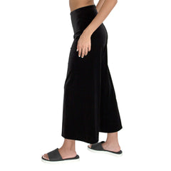 "Side view of our Cropped length Stretch Velvet Track Pant in Jet Black has elastic waist and 26"" inseam"