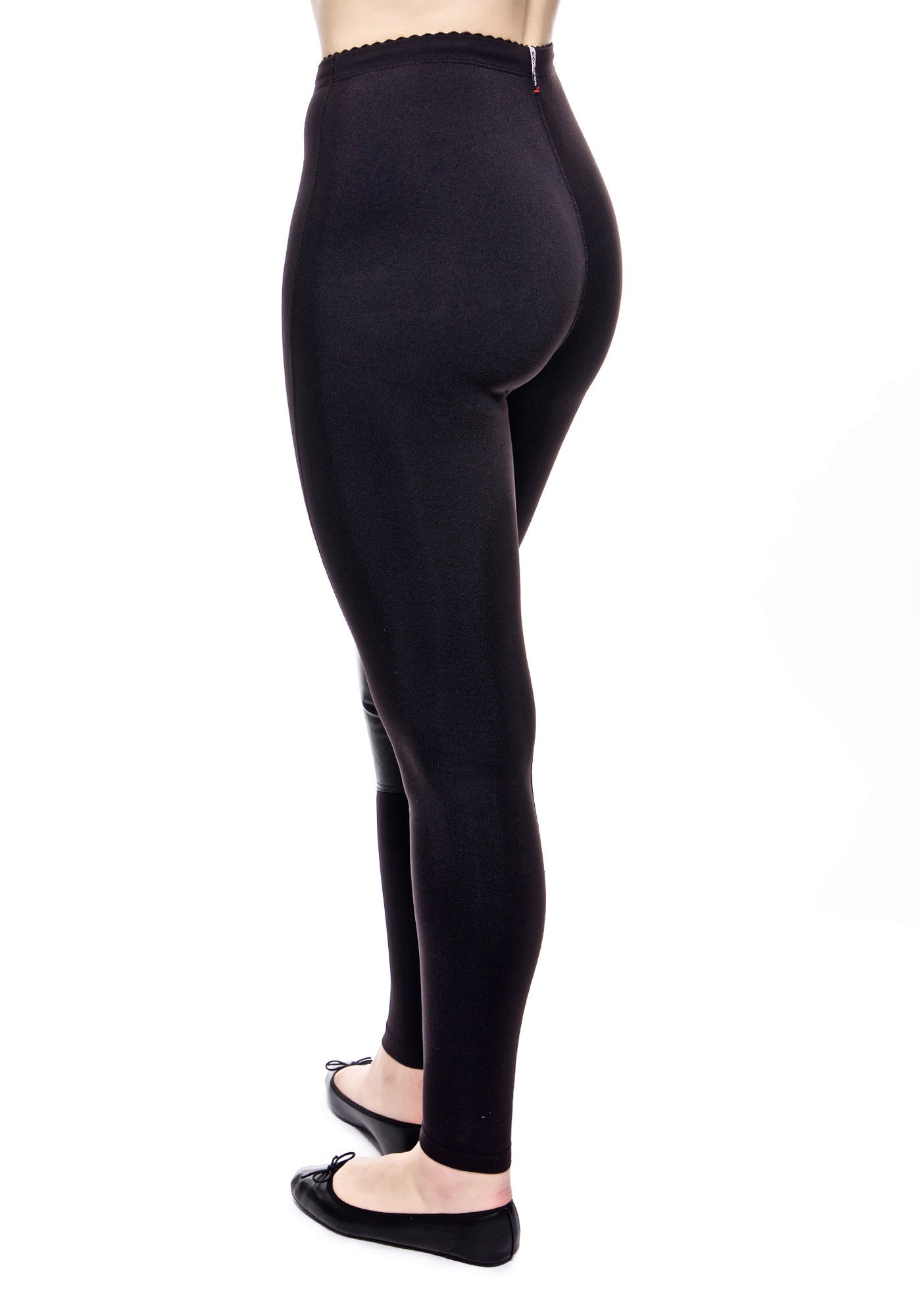Back view of the high waisted Diana legging in black has leather patch inside the knee. Made from high performance activewear fabric that wicks away moisture to keep you comfortable. Hidden drawstring at waist.