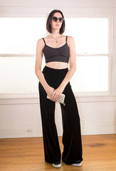 Bralette in black worn with the Veltro stretch velvet pant in Jet Black.