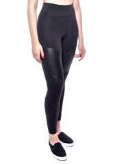 High waisted legging in black with foldover waistband, leather patches on thigh, convenient back pocket at waist. Made from premium high performance activewear fabric that wicks moisture away from your body to keep you comfortable.