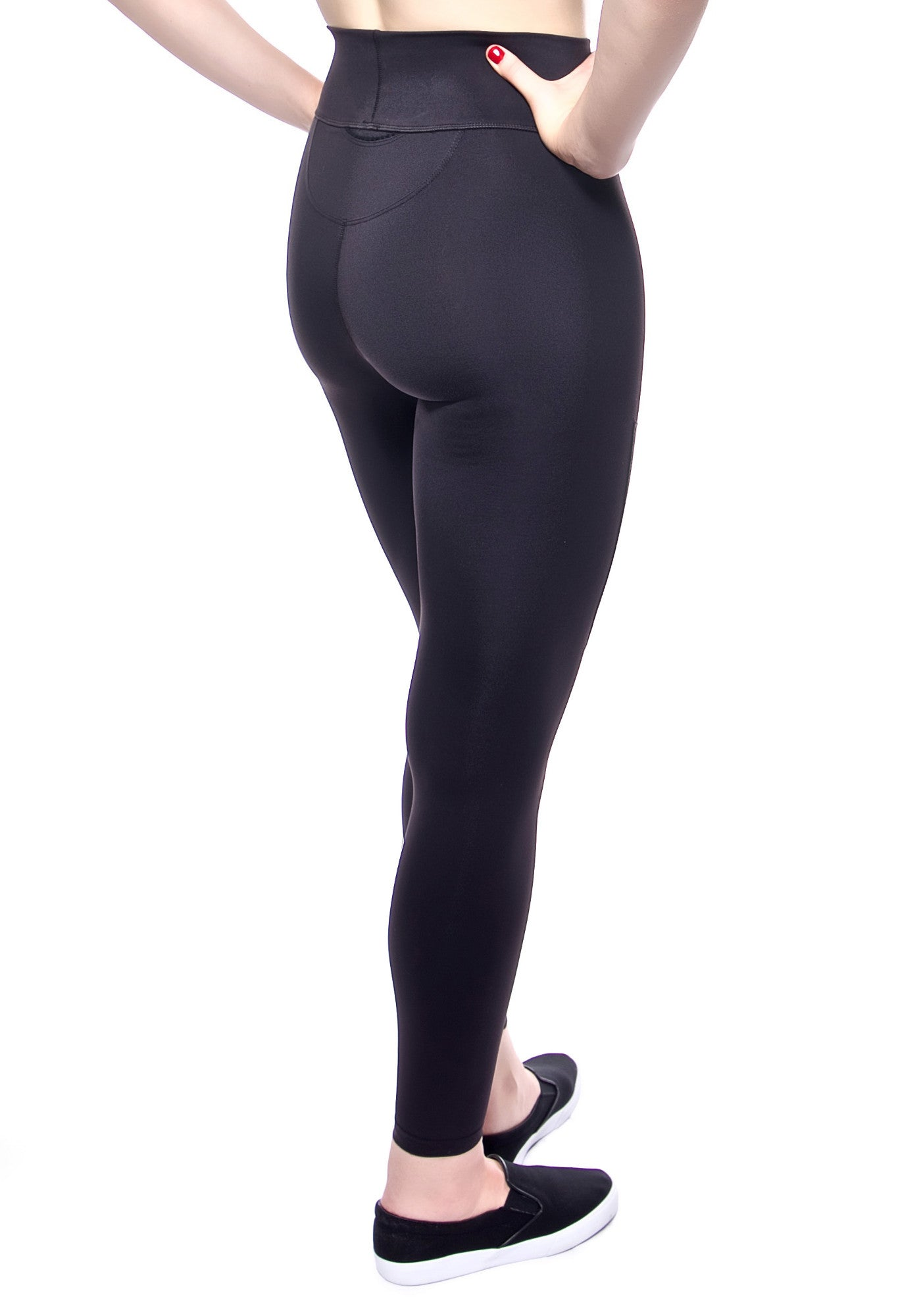 Back View. High waisted legging in black with foldover waistband, leather patches on thigh, convenient back pocket at waist. Made from premium high performance activewear fabric that wicks moisture away from your body to keep you comfortable.