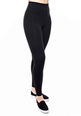 Side view of high waisted legging in Black with hidden back pocket and foldover waistband made from premium high performance activewear fabric that wicks moisture away from your body to keep you comfortable + no side seam so great for working out or traveling in comfort