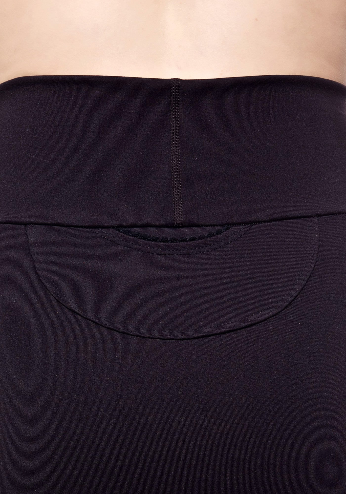 Back Pocket close up of our high waisted black mini skirt made from premium high performance activewear fabric with handy back waist pocket