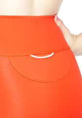 Back pocket close up of comfortable Mini Skirt in thick stretch fabric. Bright Poppy Red with contrast white panel and hem stitch. Back pocket at waist.