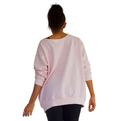 Back view of Our best selling oversized french terry top with raw edge neckline, side seam pockets shown here in Candy Pink.