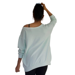 Back view of our our best selling oversized french terry top with raw edge neckline, side seam pockets shown here in Mint Green
