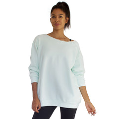 Our best selling oversized french terry top with raw edge neckline, side seam pockets shown here in Mint Green.