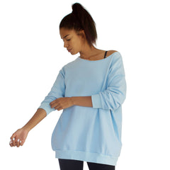 Our best selling oversized french terry top with raw edge neckline, side seam pockets shown here in Sky Blue