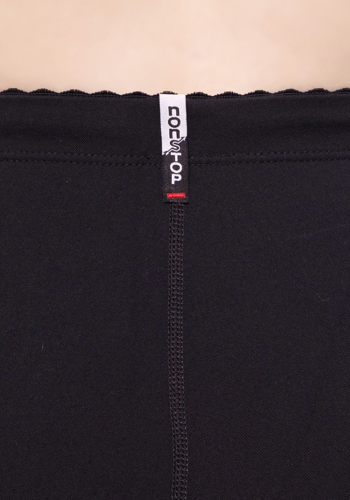 Label detail of our high waisted legging in Black with hidden drawstring at waist.