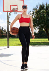Action shot of our high waisted legging in Black with hidden drawstring at waist.