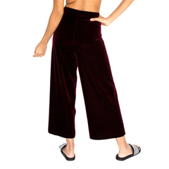 "Back view of our Cropped Length Stretch Velvet Pant in Sangria Wine (Burgundy) has elastic waist and 26"" inseam."