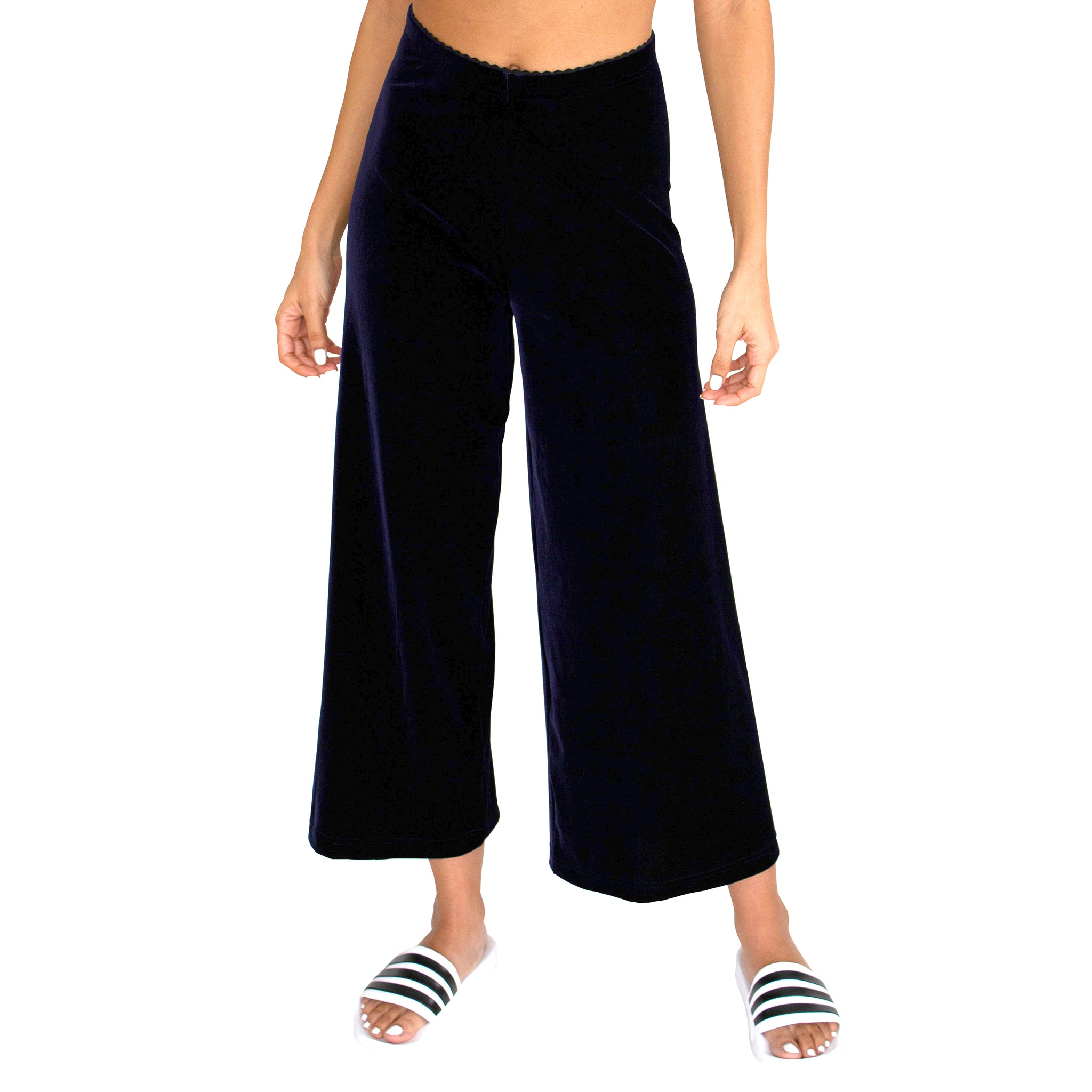"Front view of our Cropped Length Stretch Velvet Pant in Sapphire (Dark Blue) has elastic waist and 26"" inseam."