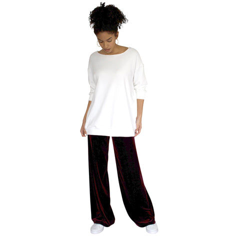 "Stretch Velvet Pant in Sangria Wine (Burgundy) has elastic waist and 32"" inseam. Worn with our Pullova top in white."