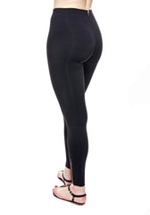 Back view of High Waisted Black Legging with Zippers at leg opening, flattering zig zag stitching detail on legs.