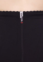 Label close up of our High Waisted Black Legging with Zippers at leg opening, flattering zig zag stitching detail on legs.