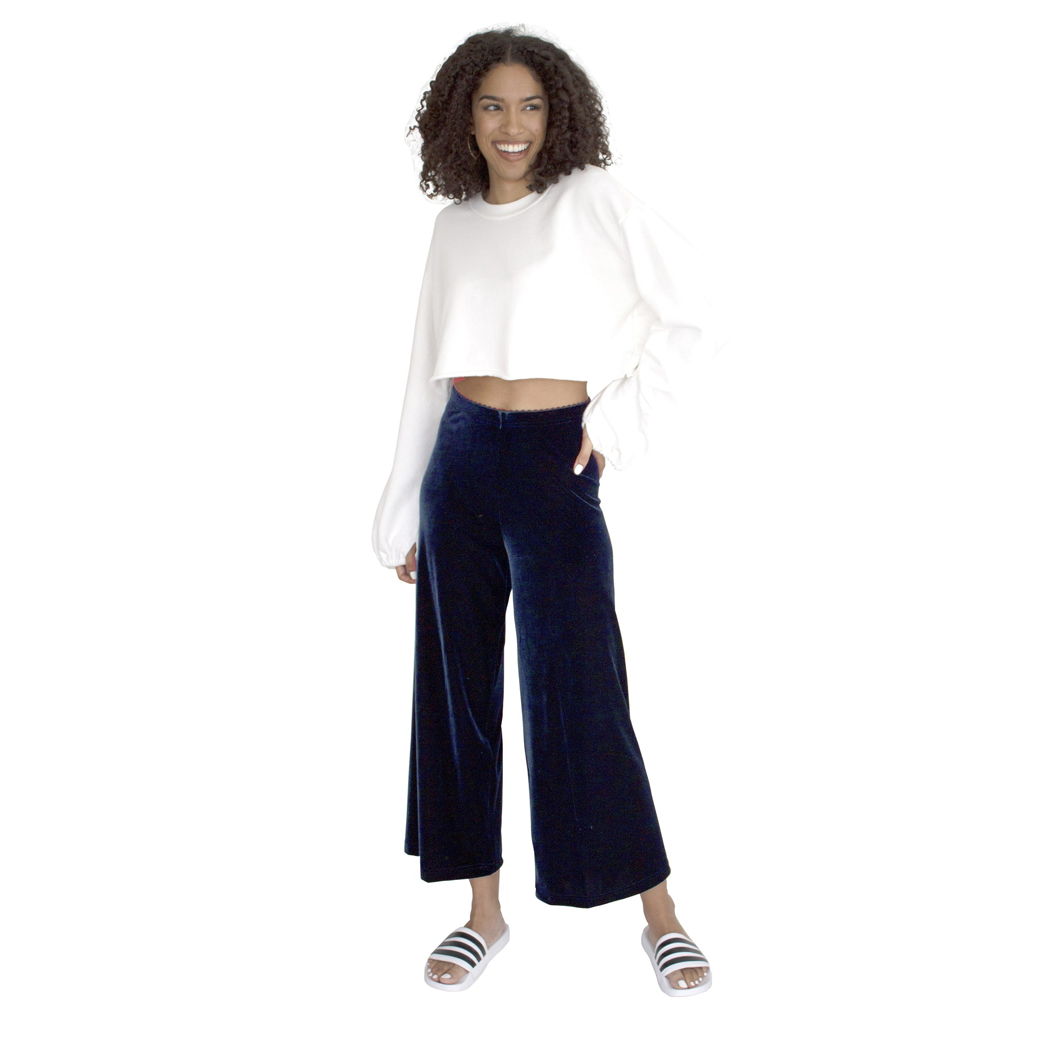 "Cropped Length Stretch Velvet Pant in Sapphire (Dark Blue) has elastic waist and 26"" inseam."