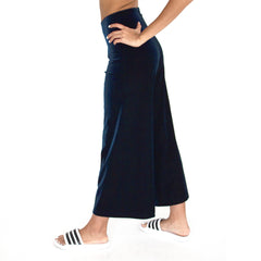 "Side view of our Cropped Length Stretch Velvet Pant in Sapphire (Dark Blue) has elastic waist and 26"" inseam."