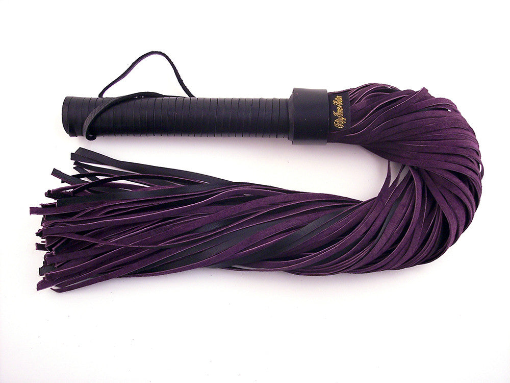 Beautifully kinky suede flogger in purple