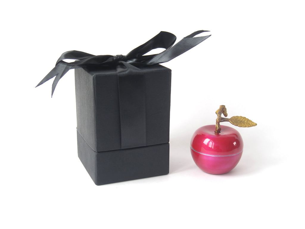 A decadent metal fruit enamelled vessel with complex fruit fragrances.