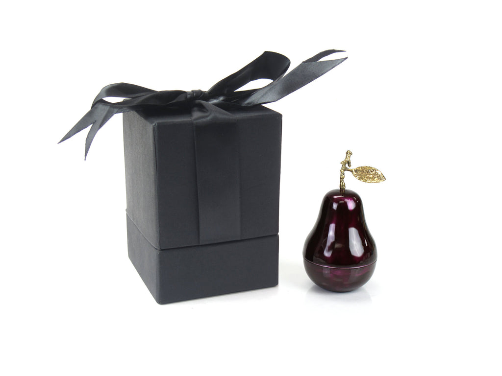 A decadent metal enamelled candle with complex fruit fragrances