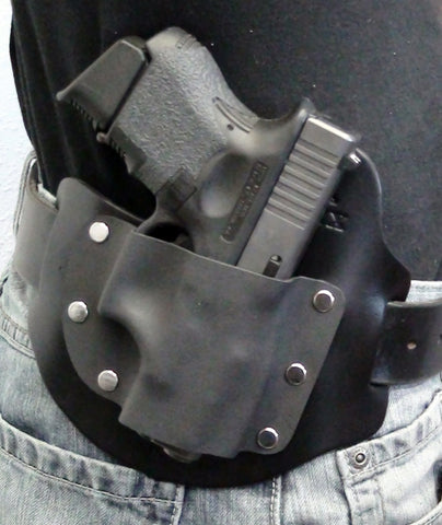 Outside the Waistband holster worn on Belt