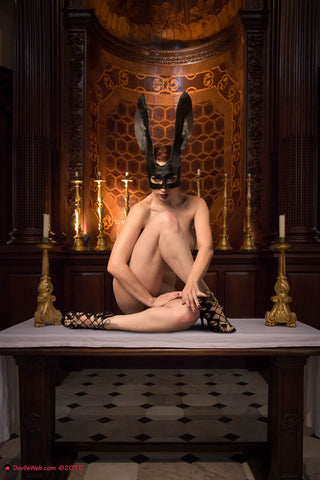 Naked girl with bunny mask on alter