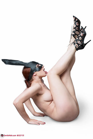 Naked girl with bunny mask with feet up in the air.k