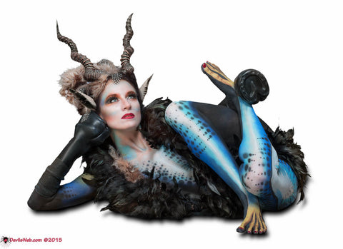 Horned and hoofed body painted girl