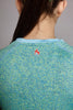 Close up back of the Teal Bold Spark short sleeve