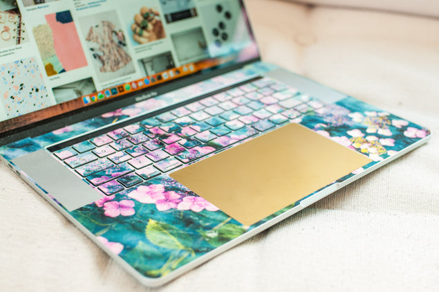 Laptop trackpad decal in gold