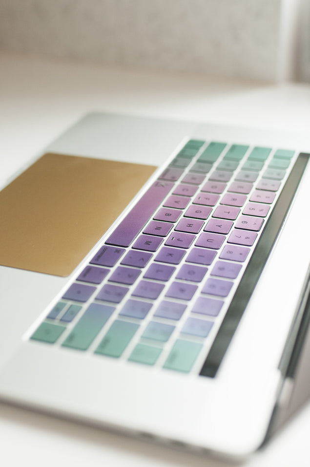 Metallic MacBook keyboard stickers in kawaii style